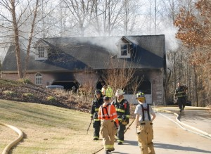 Firefighters from seven departments put out a fire in a large garage on North Main GQ Street Monday morning. The garage had significant damage, but no one was hurt. Firefighters were able to save a classic car, a 1930 REO, from the fire.