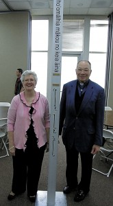 Betty Jo Hardy and the Rev. Fleming Otey with a Peace Pole from years past.