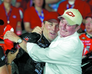 Kevin Harvick, left, is embraced by team owner Richard Childress, right, after winning the NASCAR Sprint Cup series Coca-Cola 600 auto race in Concord, N.C., Sunday, May 29, 2011. (AP Photo/Chuck Burton)
