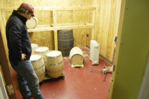 Perry Morris, distiller for Southern Grace Distilleries, stands in the barrel room at the distillery. Whiskey is aged in the barrels.