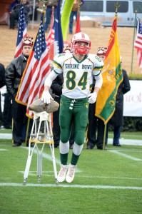 PHOTO BY PJ WARD-BROWN/FOR THE SALISBURY POST East Rowan's Seth Wyrick touches the rock during player introductions at the 78th Annual Shrine Bowl of the Carolinas on Saturday at Wofford College's Gibbs Stadium in Spartanburg, S.C.