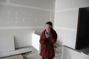 Abigail Young, of Kannapolis, talks on the phone inside what will become her bakery, Abigail's, in downtown Salisbury. Young has been running her business for about five years -- at first from her home and then a kitchen space she leases in Concord. The new bakery, which is located next to Sweet Meadow Cafe on North Main Street, is Young's first go around operating a storefront location.