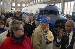 Retired pilot Bill Wilkerson, right, who flew for Piedmont Airlines, leads a tour of the restoration of a DC-3 airplane used by Piedmont Airlines at the N.C. Transportation Museum Saturday. Wilkerson is part of a group of volunteers working to restore the plane.