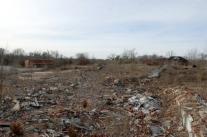 The debris field leftover from the demolition of the old mill at the former Color-Tex site north of Spencer off US 29. Bricks and wood cover most of the ground.