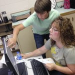 Christian Beaver offers some assistance during the Microsoft Word and Excel Academy. Submitted photo