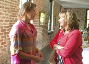 Slusser talks to former Communities in Schools boardmember Nancy Wyrick. Jeanie Groh/Salisbury Post