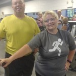Brent Parks and Norma Honeycutt were happy after a recent workout. At the end of June, Norma had lost 30.4 pounds, and Brent had lost 29.7 pounds at the halfway point of their yearlong weight loss journey. Photo by David Freeze