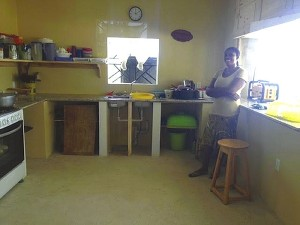 Madame Reno, the Mission Village cook, in 'Grandpa Rockwell's Kitchen' at The Hands & Feet Project's Mission Village on Ikondo Mountain in Grand Goave, Haiti