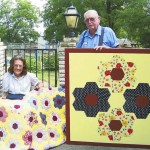 Mary L. and Maurice Parker with their barn quilt and the handmade quilt it was copied from. Maurice's mother made the original quilt for Maurice and Mary when they married years ago. Submitted photo