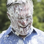 Josh Bergeron / Salisbury Post - County Commissioners Chairman Greg Edds grimaces after having several pies smashed in his face as a part of a fundraiser for an animal nonprofit group.