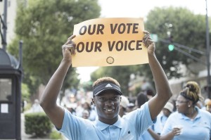 Josh Bergeron / Salisbury Post- Salisbury High School student Cameron Horne on Monday holds up a sign during a Moral Monday march in Winston-Salem.