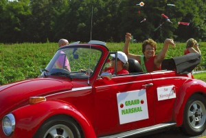 Last year's Grand Marshal Sue Herrington tosses candy to the crowd. Submitted photo.