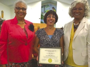 Left to right: Catherine Rivens, Chair of Human Rights Celebration; Rev. Carol Hallman, recipient of the award; Doris Brown, SRCWU President. Submitted photo.