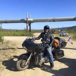 Mike Wright on his motorcycle with the Alaskan Pipeline in the background. Submitted photo