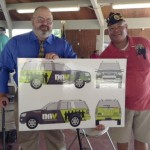 Jon Morris, left, and Otto Borden show off the new paint scheme for their transportation vehicle. David Freeze/For the Salisbury Post