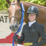Liza Towell Boyd poses with her horse, Brunello, after they won their third consecutive USHJA International Hunter Derby Championship Aug. 15 in Lexington, Ky. Photo courtesy of Tricia Booker/USHJA