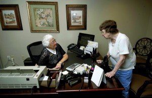 Dixie Scott, right, stops by the F&M branch at Trinity Oaks for a transaction and conversation with Daisy Fink. JON C. LAKEY / SALISBURY POST