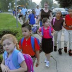Students and a few parents line the sidewalk at Landis Elementary School before the start of classes on Monday, the first day of the new academic year for Rowan-Salisbury and many other school districts. Wayne Hinshaw/For the Salisbury Post