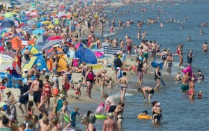 Tourists and local residents enjoy the hot weather on the beach at the Baltic seaside resort in Zinnowitz, northeastern Germany, on Friday. AP photo