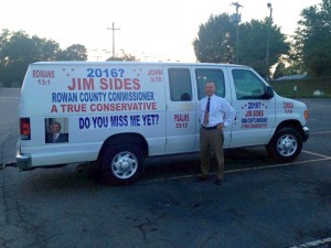 Contributed Photo - Former Rowan County Commissioner Jim Sides stands next to his famously decorated van. The van bears new stickers that imply a possible run in 2016.