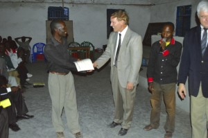 Student receiving certificate after attending classes all week.