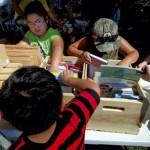 Children look through the crates of books Susannah Horton brought to Oak Mountain mobile home park. Jon C. Lakey/Salisbury Post