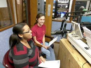 Cooperative Extension Jade Lomax and Monica Miller talking on the radio.