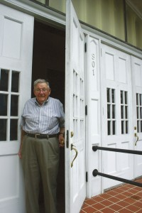 Jack Kepley stands at the front door of Coburn Memorial United Methodist Church.
