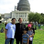 The Rev. John Eckert, center, pastor of Sacred Heart Catholic Church, and the Michael Zaldivar family on the lawn at the Capitol. Submitted photo