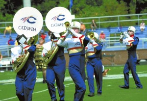 """Catawba Pride Band members perform their field production of """"Chicago"""" the musicial during the halftime show Saturday at the Catawba football game. photo by Wayne Hinshw, for the Salisbury Post"""