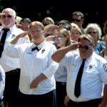 Fire service personal salute as the remains of the Lt.  Chris Phillips, a firefighter for the Locke and Churchland Fire Departments, are carried into a memorial service at Omwake-Dearborn Chapel. Jon C. Lakey/Salisbury Post