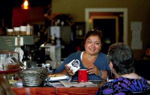 Evelyn Medina talks with one of her frequent customers at  Mean Mug coffee shop. Jon C. Lakey/Salisbury Post