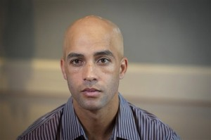 Former tennis star James Blake discusses his mistaken arrest by a NYPD officer who has a history of excessive-force complaints.  AP photo