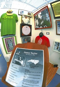 """James Taylor from Carrboro sings folk and pop songs Some of his songs are """"Your've Got a Friend,"""" """"Carolina on My Mind,"""" and """"Fire and Rain."""" The exhibit has photos and t-shirts. . photo by Wayne Hinshaw, for the Salisbury Post"""