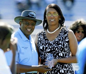 JON C. LAKEY / SALISBURY POST  Livingstone College president Jimmy R. Jenkins presents a spirit award to Moore's Chapel AME Zion Church,  Pastor Carolyn Bratton accepted the award.  Several awards were handed out during halftime of the Livingstone College football game. The West End Classic Community Spirit awards were handed out in three catergories; group, organization and individual.  Saturday, September 19, 2015, in Salisbury, N.C.