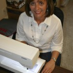 Since she was not quite ready to retire, Angela Graham started a home-based business, Flossie Jean, which offers bibs and burn cloths. 'Chic Necessities for Today's Baby' is her business slogan. Susan Shinn/For the Salisbury Post
