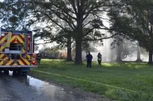 Firefighters on the scene of a Monday morning fire on Miller Road. Rebecca Rider/Salisbury Post