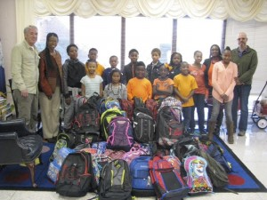 Salisburians Jim Dunkin, far left, and Nathan Coyle, far right, pose with a Columbia, S.C., teacher and her students — and their new backpacks from Salisbury. Submitted photo