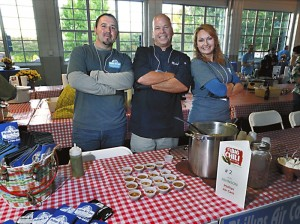 Phillips Air Care table:   Kelly Efird, Mike Johnson, and Ashley Efird at the Waterworks Chili Cook Off .  photo by Wayne Hinshaw, for the Salisbury Post