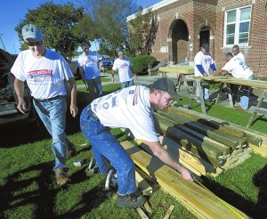 Rowan County United Way Day of Caring.   Williiam Barger from St. Peter's Lutheran Church measures lumber.  photo by Wayne Hinshaw, for the Salisbury Post