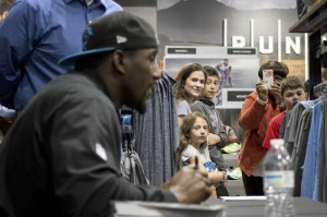 Josh Bergeron / Salisbury Post - Fans look on as Carolina Panthers linebacker Thomas Davis signs autographs Saturday during an event at the newly opened Dick's Sporting Goods in Salisbury.
