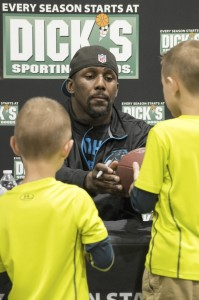 Josh Bergeron / Salisbury Post - Carolina Panthers linebacker Thomas Davis hands off a signed football to two young fans during an event at the newly opened Dick's Sporting Goods in Salisbury.