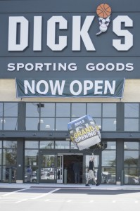 Josh Bergeron / Salisbury Post - Evan Workman, who was promoting the grand opening of Dick's Sporting Goods on Friday, walks around outside of the store with a large balloon.