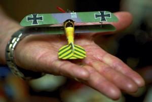 Sam Morgan holds a very detailed German World War II fighter, the Albatros.  JON C. LAKEY / SALISBURY POST