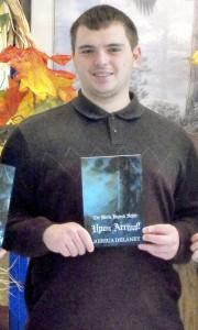 Joshua Delaney with his book.