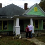 Owners Darlyn and Evan Baldwin stand outside their newly painted house on Thiurd Street, Spencer. Submitted photo