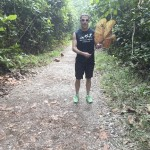 Alan Fowler holds a massive leaf while on a run in McRitchie Park, Singapore. Photo by Delaine Fowler