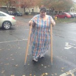 Kristy Bell walks with her new walking sticks. Submitted photo