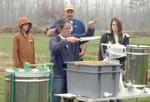 Cooperative Extension Bevin Fink from Third Creek Cottage Gardens speaks to NC Farm School participants on beehives.