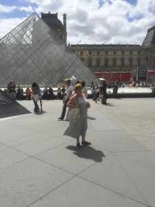 Annick Nurisso stands in front of the glass pyramid by the Louvre in Paris in July 2015.  Submitted photo